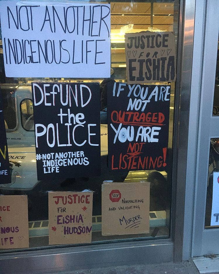 protest posters on Winnipeg police headquarters